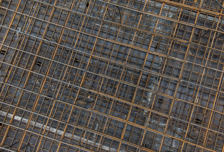 Steel bars reinforcement on construction site, top view, editable background. Formwork used on construction sites for concrete layering, top view.