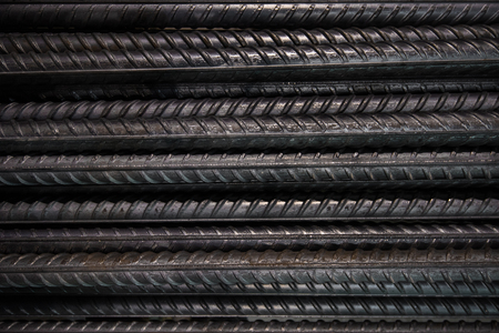 steel bar: Artistic steel bars closeup, reinforcement on construction site, editable background.Steel bars or rods used on construction sites for concrete layering.