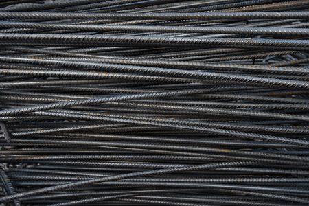 strong foundation: Artistic steel bars closeup, reinforcement on construction site, editable background. Steel bars or rods used on construction sites for concrete layering.