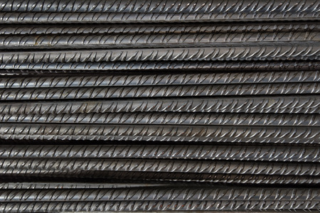 Artistic steel bars closeup, reinforcement on construction site, editable background. Steel bars or rods used on construction sites for concrete layering.