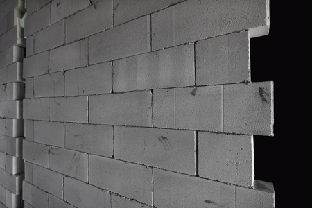 aerated: Raw AAC autoclaved aerated concrete wall, angle view, editable background.