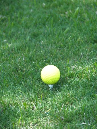 achievment: golf ball and tee Stock Photo