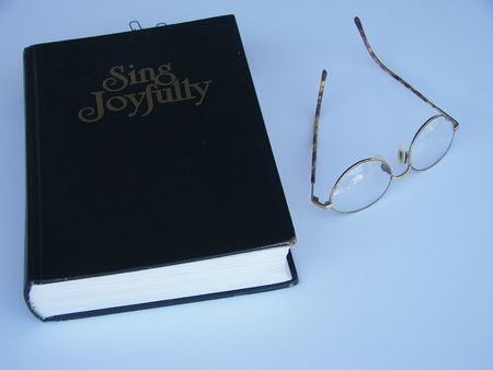 glasses laying by a music book