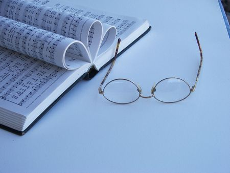 glasses laying by a open music book