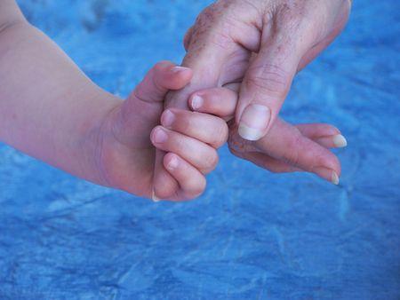 Grand daughter holding Grandma's finger Stock Photo - 891327