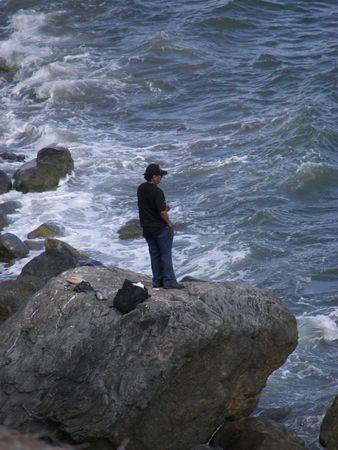 man standing on a rock Standard-Bild