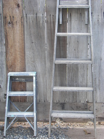 Two different sizes of ladders Standard-Bild