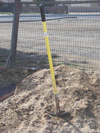 shovel in dirt: Shovel in a pile of dirt
