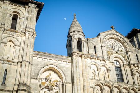 The moon on a blue summer sky over a church in Bordeaux