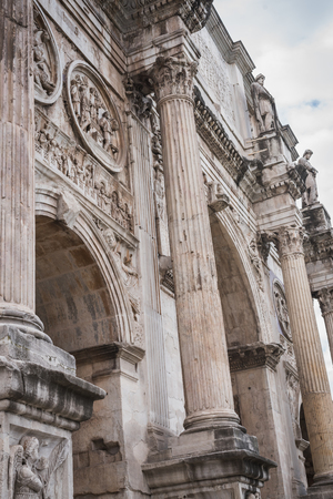 Close-up of Arco di Constantino near the Colosseum in Rome Italy