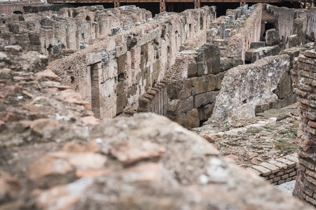Close-up on the old stones of the basement of the Colosseum in Rome Italy 免版税图像