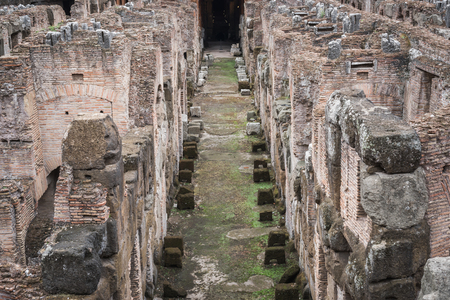 Old stones of the basement of the Colosseum in Rome Italy