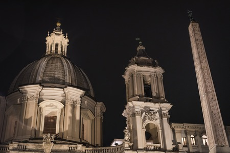 Building and obelix of Piazza Navona by night in Rome Italy