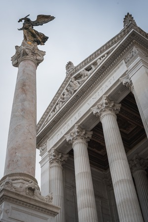 Column and statue at the entrance of the Vittorio Emanuele II monument in Rome Italy Reklamní fotografie - 122796268