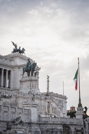 Monument to Vittorio Emanuele II with the Italian flag in Rome Italy