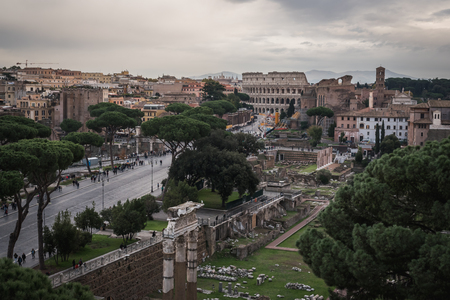The ruins and the Colosseum of Rome from the monument Vittorio Emanuele II in Italy