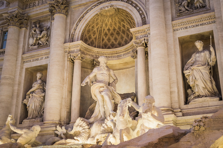 Statues of the Trevi Fountain at night in Rome Italy