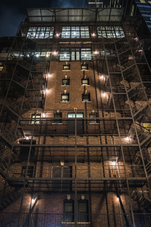 Typical old New York building at night in Manhattan