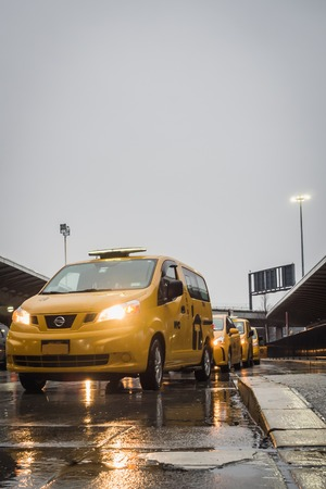 NEW YORK, USA - FEBRUARY 22, 2018: New York Yellow Taxi Queue on Rainy Day at JFK Airport