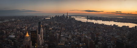 Huge cinematic panorama at the sunset over the city of New York City Фото со стока
