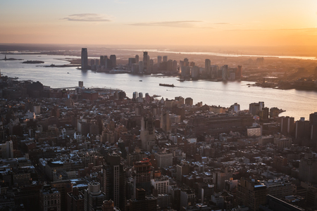 Aerial sunset over Manhattan from a high point of view in NYC