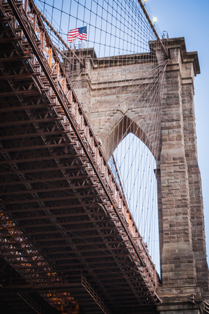 Close-up from below of one of Brooklyn Bridges arches in New York City Stock Photo