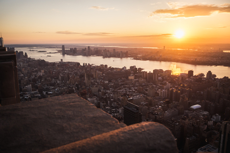 Aerial view of sun shining at sunset over Manhattan and Jersey in New York Stock Photo