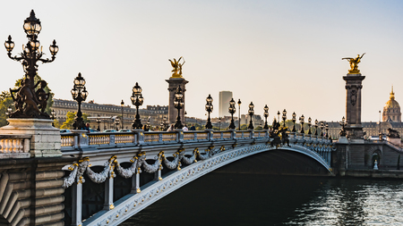 Morning sunrise against the light on the beautiful Pont Alexandre III in Paris France 版權商用圖片