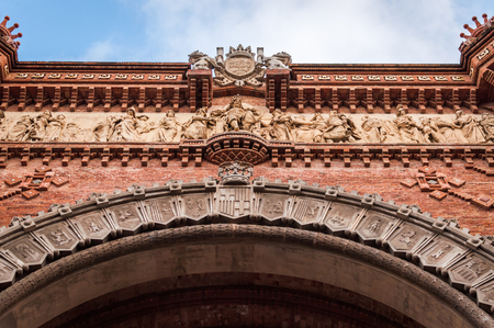 Close up on the beautiful details of the red triumphal arch of Barcelona Spain