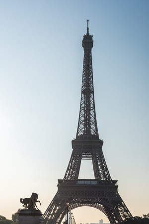 Morning sunrise in backlight on the Eiffel Tower in Paris France