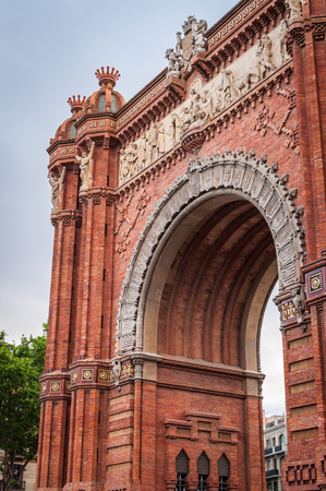 Side Architectural Close-up of Monumental Red Brick Arch in Barcelona Spain Фото со стока