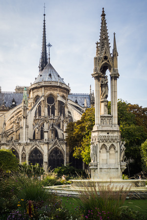 The back of Notre Dame Cathedral from the park in summer in Paris, France Фото со стока