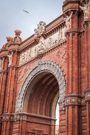 Architectural Close-up of Monumental Red Brick Arch in Barcelona, Spain