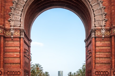 Architectural close-up on the center of the monumental red brick Arch of Barcelona in Spain Фото со стока