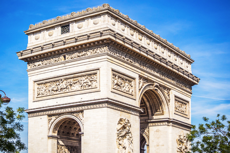 The beutiful and monumental Arch of Triumph Napoleonic on the Place of the General De Gaulle in Paris during a beautiful sunny summer day in France