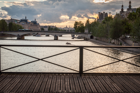 Sunset landscape on the Seine River in Paris from the Pont des Arts in summer