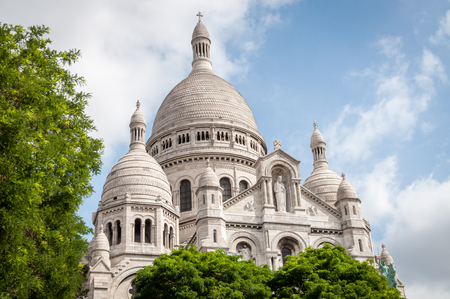 The iconic basilica of the Sacre Coeur in Montmartre under a beautiful blue summer sky in Paris