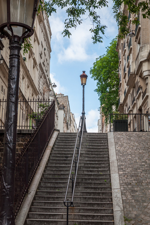 Stairs in the famous streets of Montmartre in Paris under a beautiful blue summer sky