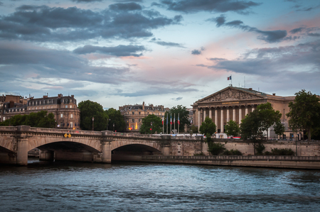 Blue and pink sunset over the National Assembly and the Seine River in Paris