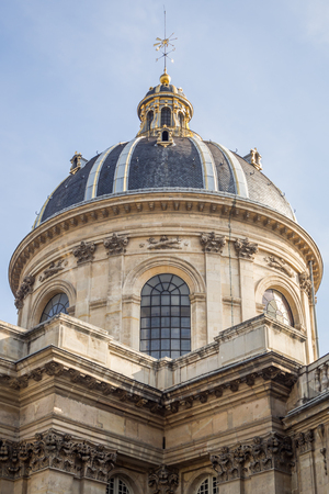 Close up on the dome of the Institut de France facing the Pont des Arts in Paris by a summer day
