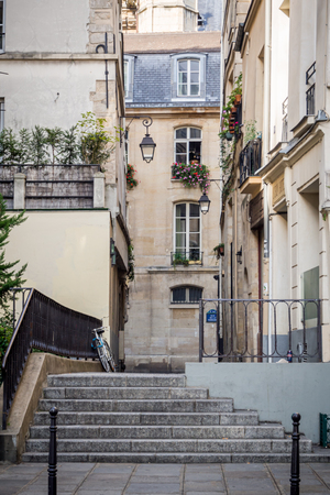 Small pedestrian walkway overlooking the rue de la Verrerie in the district of the Hotel de Ville in Paris Фото со стока