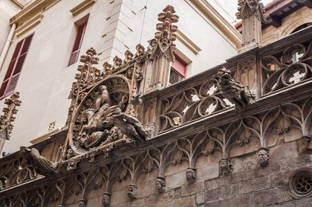 Gargoyles of the Carrer del Bisbe Bridge next to the Venice Bridge of Sighs in the Gothic Quarter of Barcelona 写真素材