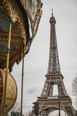 The Eiffel Tower near the carousel of Paris - Parisian Landscape