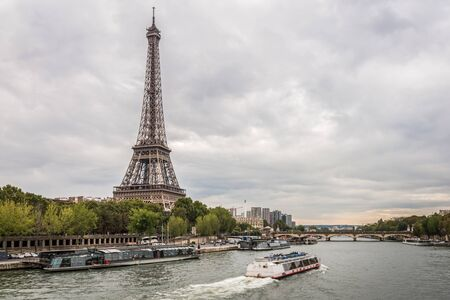 Cloudy evening summer sunset at the Eiffel Tower and the Seine river in Paris 写真素材