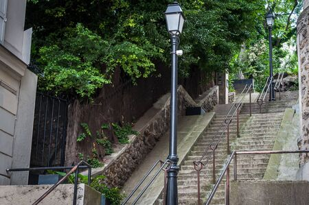 The stairs of Montmartre leading to the Basilica of the Sacred Heart during the day in the mythical old Paris 스톡 콘텐츠 - 124986953
