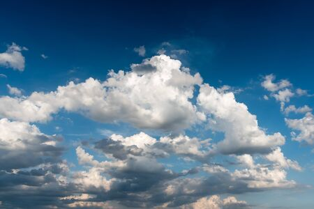 Cloudy sky before a sunset over blue sky in the daytime in summer - sky landscape