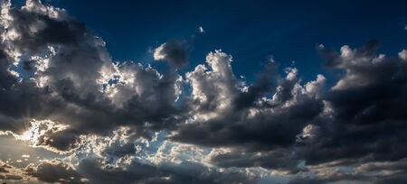 Dramatic sky and cloudy before a storm at sunset - Overcast sky landscape Stockfoto - 128571387