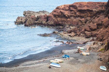 Boats parked on the volcanic coast of El Golfo in the island of Lanzarote - Canary islands