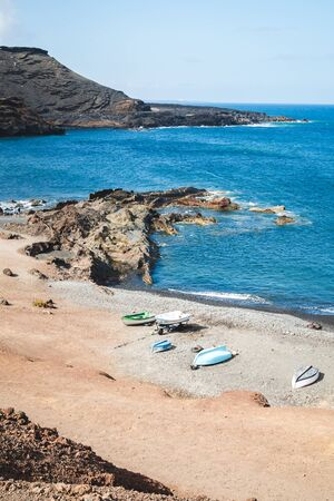 Boats parked on the volcanic coast of the island of Lanzarote - Canary islands