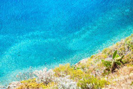 Turquoise ocean at the foot of the cliff in Madeira